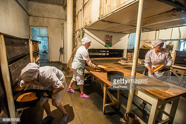 Workers of the Nikitin Kolkhoz bakery prepare bread Ivanovka village Azerbaijan Bakery makes bread for local people Children from school and...