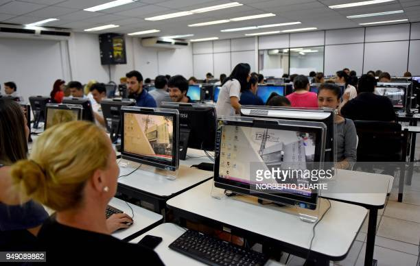Workers of the Paraguayan Electoral Justice get ready at the compute room of the Superior Court of Electoral Justice ahead of the upcoming April 22...