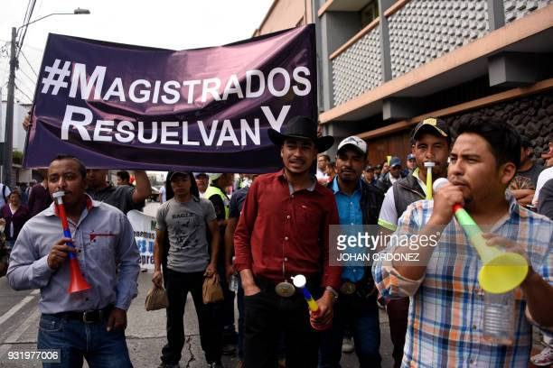 Workers of the silver mining company San Rafael the Guatemalan branch of the Canadian Tahoe Resources take part in a protest demanding the Guatemalan...