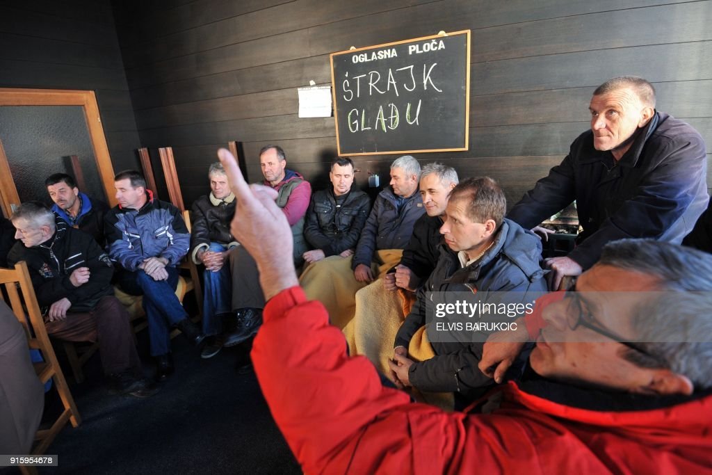 Workers of the Zenica Ironworks (Zeljezara Zenica) industry sit in a room during a hunger strike, on January 22, 2018, in Zenica. After Bosnia's war in the 1990s, business gradually went downhill like at many state-run firms hit by both the transition to a market economy for which they were not equipped, and mismanagement. According to trade unions, between 50,000 and 65,000 former or current employees of mostly state companies, such as hospitals, mines or public transport, will not get their pension, as the companies had not been paying into the state pension fund. Tax authorities estimate that unpaid social contributions amount to almost two billion euros, or half of Bosnia's annual national budget. /