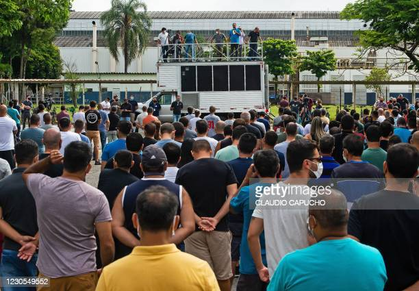 Workers of US automaker Ford attend a protest in front of the Ford manufacturing plant in Taubate, Sao Paulo state, Brazil on January 12, 2021. -...