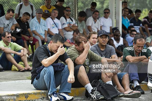Workers of US carmaker General Motors listen to their union leaders during an assembly on the first day of an indefinite strike after the company...