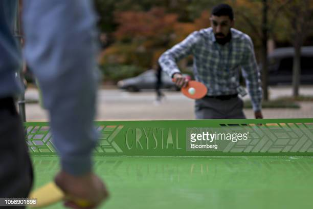 Workers on a break play table tennis outside the 1851 S Bell Street building in the Crystal City area of Arlington Virginia US on Wednesday Nov 7...