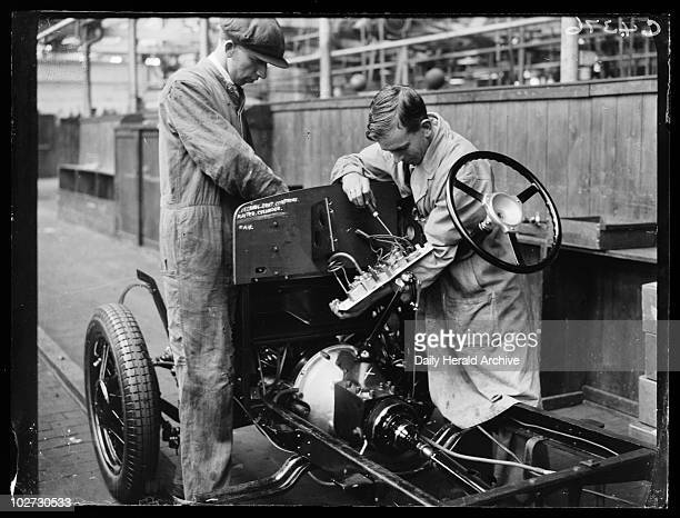 Workers on a car assembly line 1933 A photograph of workers on the car assembly line of the Triumph Works in Coventry West Midlands taken by Leslie...