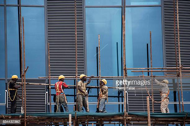 Workers on a construction site downtown Kigali Kigali with a population of more than one million is Rwandas capital and main city The city is built...
