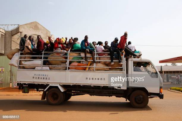 Workers on a goods truck Uganda
