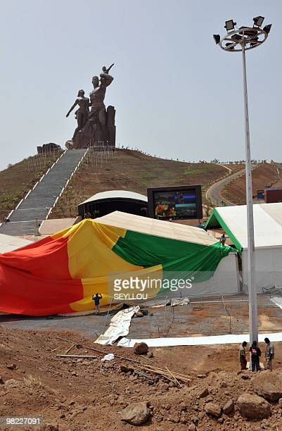 Workers on April 1 2010 put up the Senegalese national flag in preparations for the inauguration of the 'African Renaissance Monument' in Dakar The...