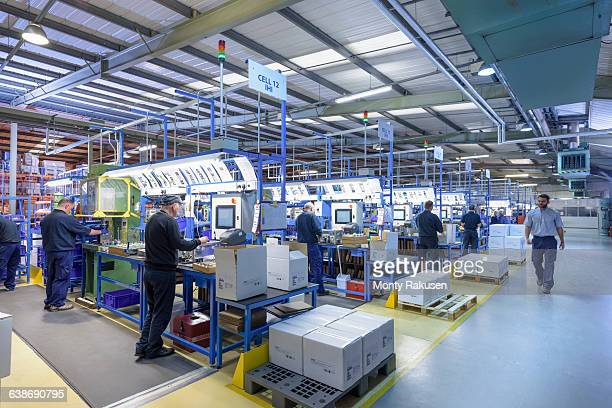 Workers on automotive parts production line in automotive parts factory
