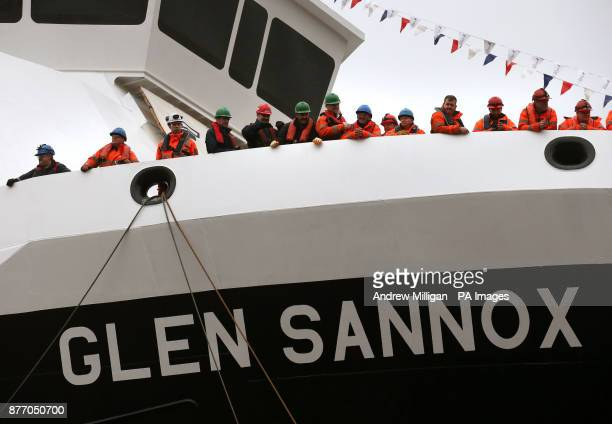 Workers on board the ferry MV Glen Sannox at the launch ceremony for the liquefied natural gas passenger the UK's first LNG ferry at Ferguson Marine...