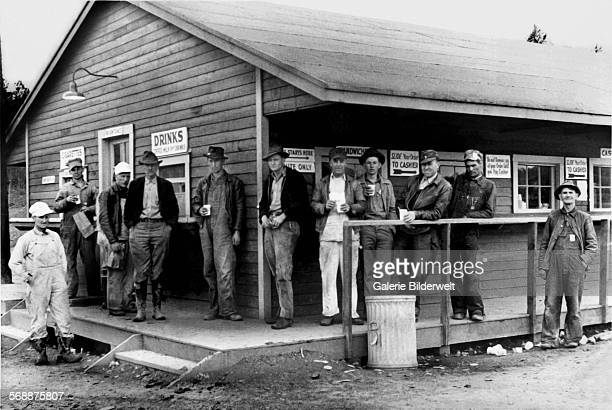 Workers on break at a store 19th April 1944 Oak Ridge The town of Oak Ridge was established by the Army Corps of Engineers as part of the Clinton...