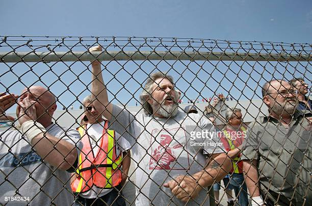Workers on break at the GM plant in Oshawa cheer on thousands of autoworkers and their supporters as they rally outside the assembly facilities on...