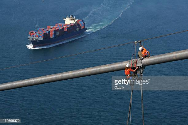 workers on bridge - suspension bridge stock photos and pictures