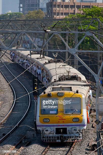 Workers on crowded commuter train of Western Railway near Mahalaxmi Station on the Mumbai Suburban Railway India