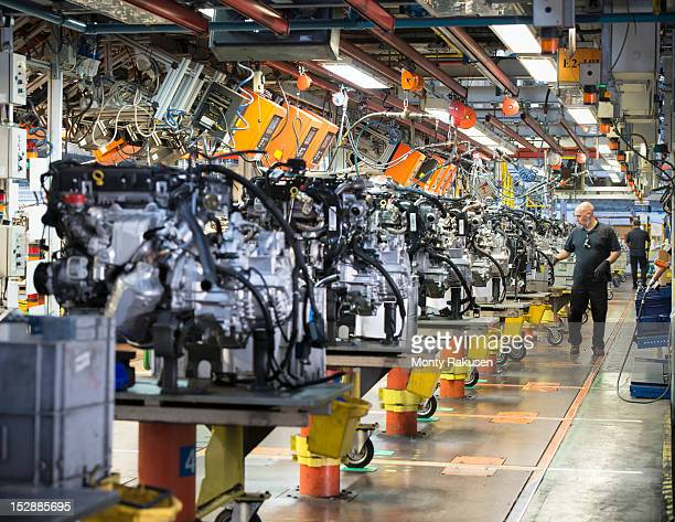 Workers on engine production line in car factory