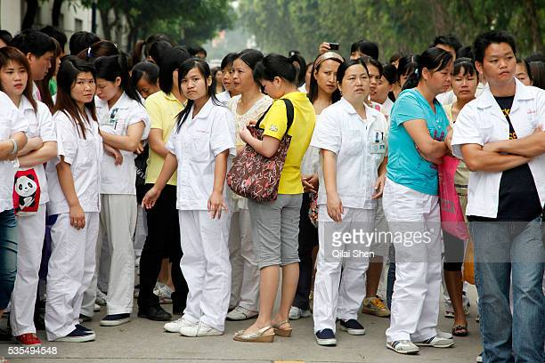 Workers on strike wait outside the Honda Lock factory in Zhongshan China on Friday 12 June 2010 China's vast labor force is increasingly using...