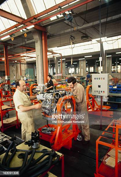 Workers on the assembly hand build the Boras V8 engine.