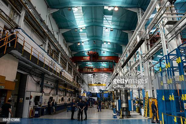 Workers on the factory floor of Hayward Tyler manufacturing facility in Luton north of London on August 24 2016 Hayward Tyler designs manufactures...
