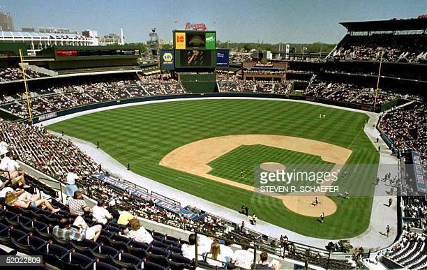 Workers on the field prepare the new Turner Field stadium for the first game to be played there, an exhibition game between the Atlanta Braves and...