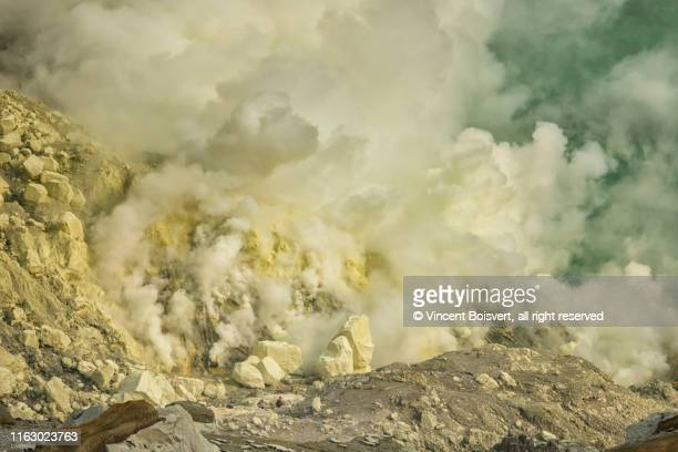 workers on the kawah ijen, java, indonesia - sulfuric acid stock photos and pictures
