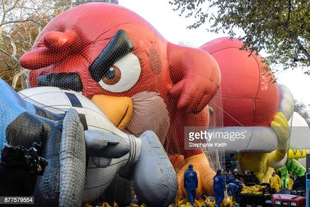 Workers on the Macy's inflation teams inflate balloons near Central Park ahead of the Macy's Thanksgiving Day parade on November 22, 2017 in New York...