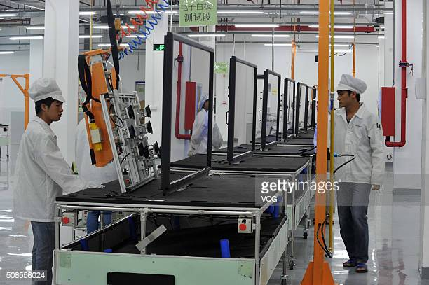 Workers on the production line at Foxconn demonstration plant on July 10 2014 in Guiyang Guizhou province of China CEO of Foxconn Guo Taiming arrived...
