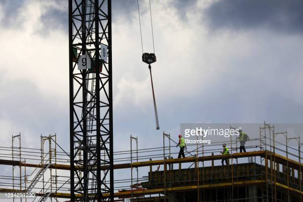 Workers on the Quartier Heidestrasse residential building project in Berlin, Germany, on Thursday, July 29, 2021. Germany reports gross domestic...