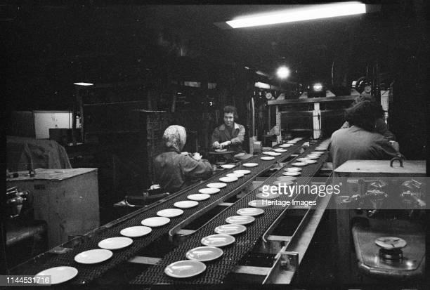 Workers on the shop floor Wear Flint Glass Works Alfred Street Millfield Sunderland 1961 Women working beside a conveyor belt carrying plates along a...