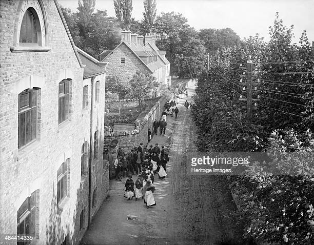 Workers on their way to work at the Early Blanket Factory Witney Oxfordshire c1860c1922
