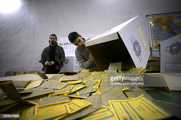 Workers open the ballots in a polling station in downtown Romein a polling station in Rome on February 25 2013 at the end of the second day of the...