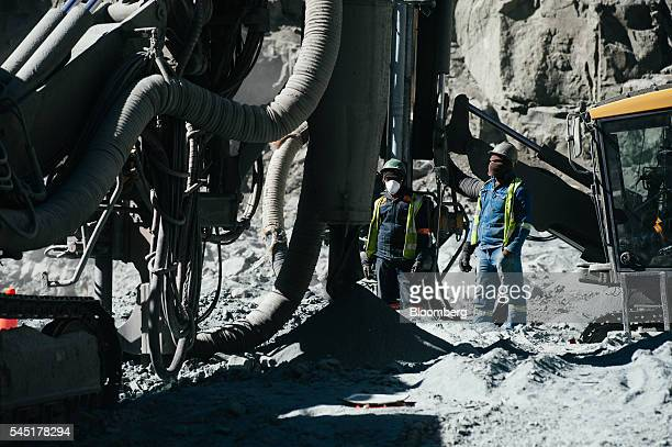 Workers operate a drilling rig preparing for rock blasting in the satellite pit at the Letseng diamond mine operated by Gem Diamonds Ltd in Letseng...