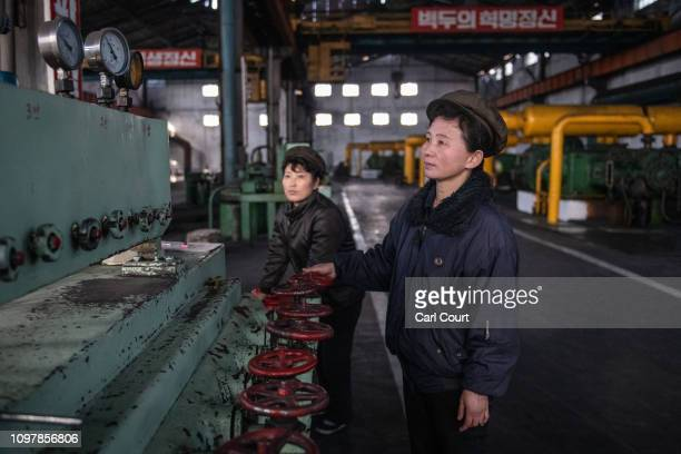 Workers operate a machine in Hungnam Fertilizer Complex on February 04 2019 in Hamhung North Korea US President Donald Trump and North Korean Supreme...