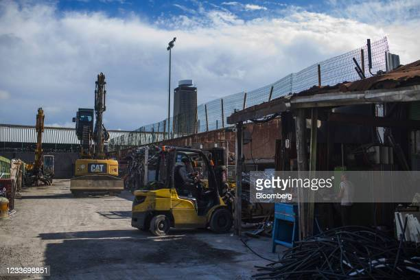 Workers operate forklifts and cranes at a scrap and metals recycling yard in Paris, France, on Monday, June 28, 2021. Commoditieshave rallied 18%...