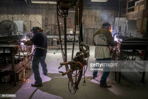 Workers operate metal inert gas welders to join seams at the Metal Manufacturing Co facility in Sacramento California US on Thursday April 12 2018...