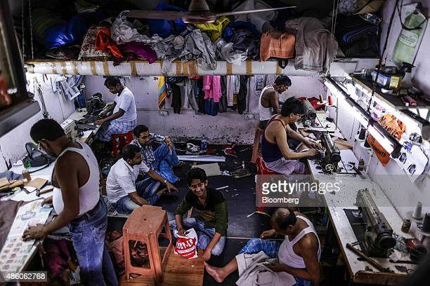 Workers operate sewing machines at a leather workshop in the Dharavi slum area of Mumbai India on Saturday Aug 29 2015 India's benchmark stock index...