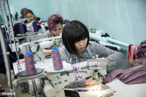 Workers operate sewing machines at an Alinex garment factory in Bishkek, Kyrgyzstan, on Wednesday, April 18, 2018. The Kyrgyz Republic ranked 77th of...