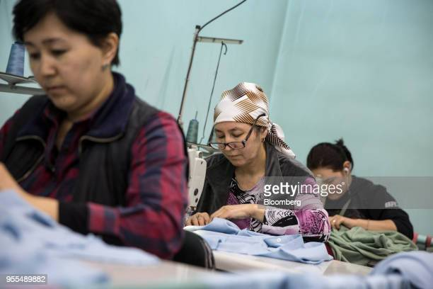 Workers operate sewing machines at an Alinex garment factory in Bishkek Kyrgyzstan on Wednesday April 18 2018 The Kyrgyz Republic ranked 77th of 190...