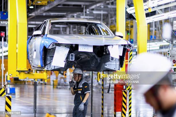 Workers operate the car assembly line at the new automobile plant of VinFast Vietnam's first homegrown car manufacturer in Haiphong on June 14 2019