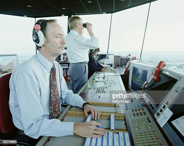 Workers operating air traffic control tower