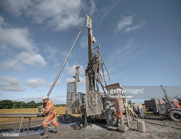 workers operating drilling rig to explore for coal in field - モーペス ストックフォトと画像