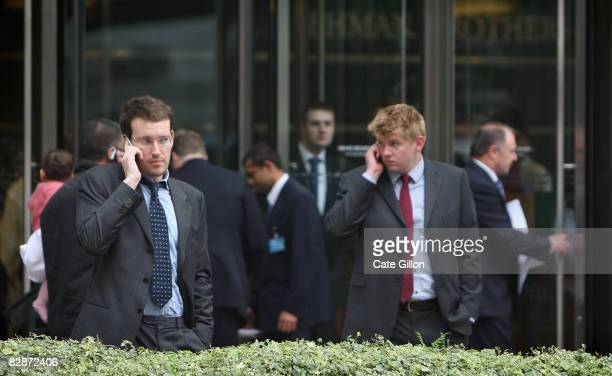 Workers outside Lehman Brothers' Canary Wharf office on September 15, 2008 in London, England. The fourth largest American investment bank has...