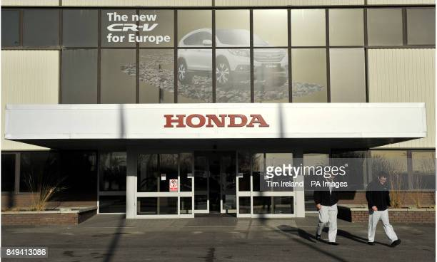 Workers outside the Honda assembly plant in Swindon where the car giant is to cut 800 jobs after a slump in demand across Europe