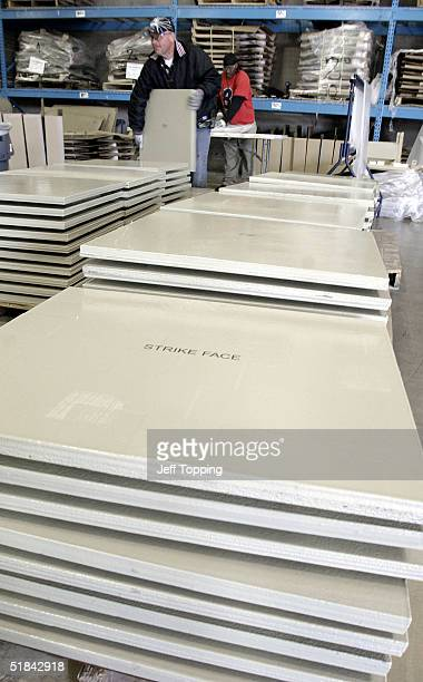 Workers pack ballistic panels part of the ArmorWorks Ballistic Advantage Armor kits December 9 2004 in Tempe Arizona The company supplies the...
