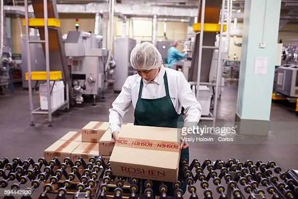Workers pack chocolate products in factory on June 19 2016 in Vinnytsia Ukraine Roshen Confectionery Corporation is a Ukrainian confectionery...