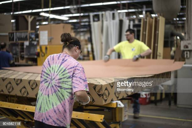 Workers package a window frame at the Pella Corp manufacturing facility in Pella Iowa US on Thursday Feb 22 2018 The US Census Bureau is scheduled to...