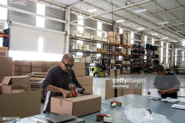 Workers package aircraft components for shipment at the Tighitco Inc manufacturing facility in San Luis Potosi Mexico on Thursday Nov 16 2017 With...
