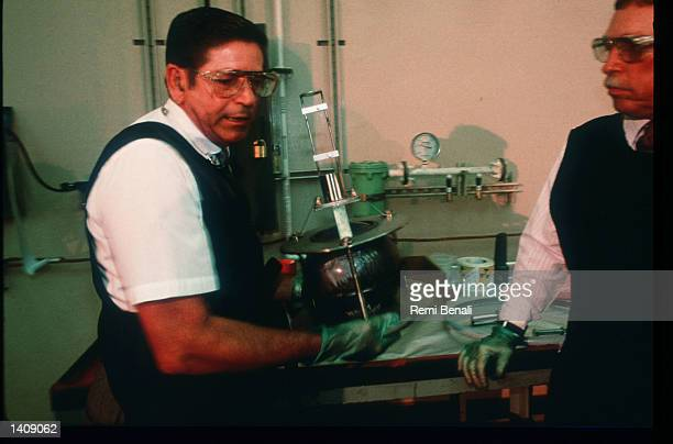 Workers package an AT400 container at the Pantex Plant March 1996 near Amarillo TX The Pantex Plant has dismantled about 50000 atomic bombs since it...