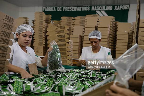 Workers package condoms made with native latex at the Natex factory that produces around 100 million condoms per year for the Brazilian Health...