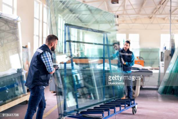 workers packaging glass sheets in warehouse - making stock pictures, royalty-free photos & images