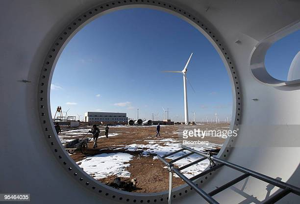 Workers paint and assemble parts of wind turbines in Yumen, Gansu province, China, on Friday, Nov. 13, 2009. China is under pressure from the...