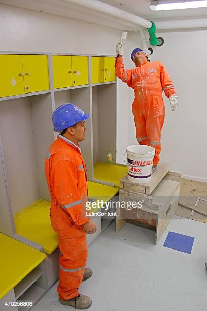 Workers paint the dressing rooms of Estadio Municipal de Concepción Alcaldesa Ester Roa Rebolledo prior to Copa America Chile 2015 at Concepcion...